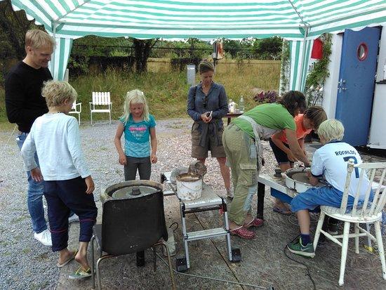 "Kajsas Konst & Keramik: ""Try pottery"" outside the studio during Happy Childrens Day in Kivik"