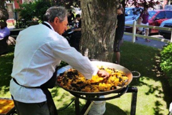 Basalt, CO: Owner and Chef Javier Gonzalez-Bringas making paella for an outdoor dinner party in the garden