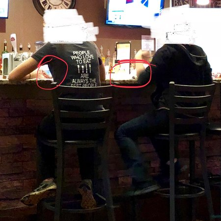 Sidelines Italian Grille: Employees in dining area (bad place for it) wrapping utensils & handling cell phone (left) & cas
