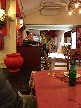 Koutouki The Rakomelo: Waitress keeping our kids entertained