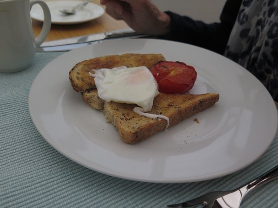 Staffa House: A modest single poached egg with tomato