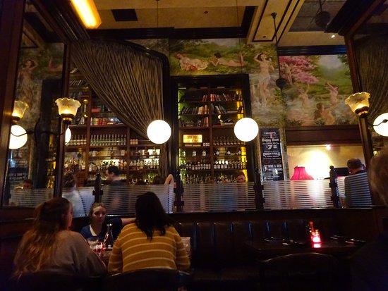 The Misfit Restaurant & Bar: Rich wood trim with naked lady paintings