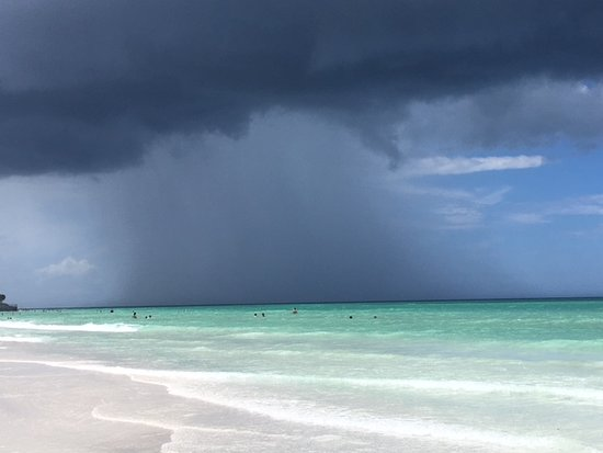 Siesta Sun Beach Villas: Storm in the distance, but watched it from my sunny chair