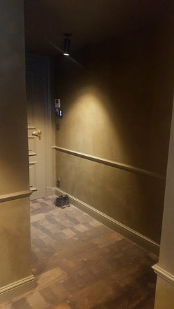 """Le Sanglier Des Ardennes: """"Deluxe Room"""" - entry with those horrible splinter floors"""