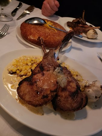 Gianni's Steakhouse: Pork chops with creamed corn/bacon. Potato Papalette in background.
