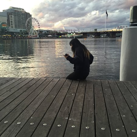 Darling Harbour: sitting on te boardwalk in front of the IMAX theatre