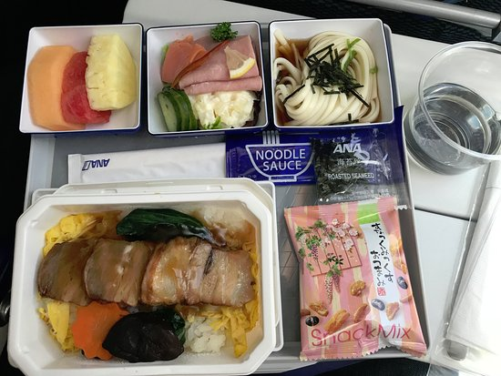 ANA (All Nippon Airways): Brazed pork - with a bit of sake on the side.