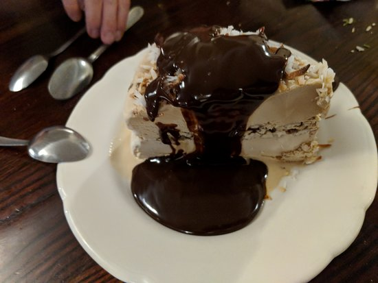 Haverhill, MA: Best dessert ever! Coffee ice cream wedge, with pecans, coconut frosting, and hot fudge sauce!