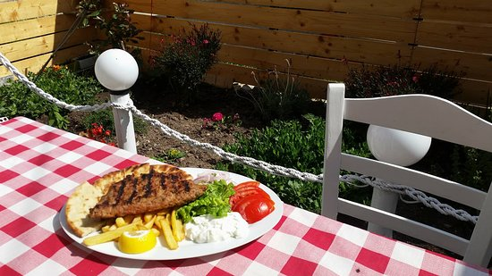 I Love Souvlaki: Homemade burger filled with goudha cheese served with french fries, tomato, bread & tzatziki