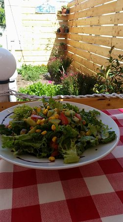 I Love Souvlaki : Our Love salad is made of lettuce,sun dried tomato,fresh tomatoes cucumber cubes and corn crops.