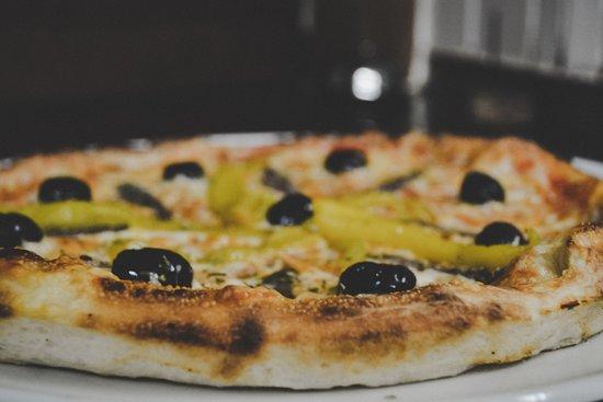 Ristorante Pizzeria Il Mulino: Knusprige Pizzen aus unserem Ofen.