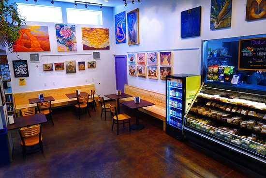 Moonflower Community Cooperative: Our deli area with spacious tables and rotating local art displays