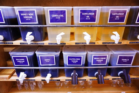 Moonflower Community Cooperative: Bring your own containers to refill on staple bulk liquids, such as olive oil and tamari