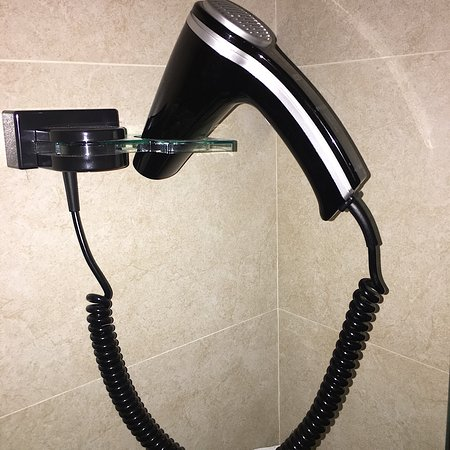 Zest Hotel Sukajadi: Hair dryer mounted on the wall in the bathroom