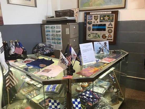 Sebring, FL: A display of medals, flags, documents and patches inside the museum