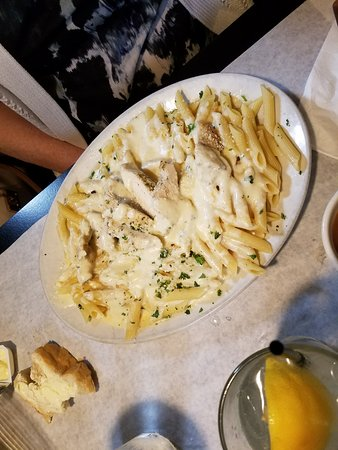 Combine Brothers Bar & Grille: Alfredo with Chicken. Alfredo sauce sloppily applied.