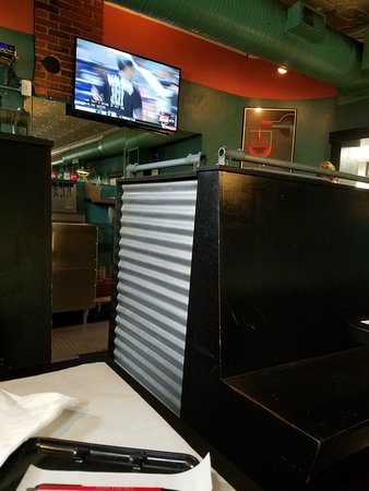 Combine Brothers Bar & Grille: View from my booth seat into the server waitress station. Kitchen door access is to the right.