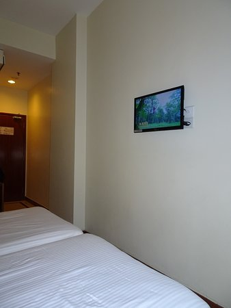 """First World Hotel, Resorts World Genting: Tiny 24"""" TV with fuzzy channels. You can plug in a USB drive and watch your own videos."""