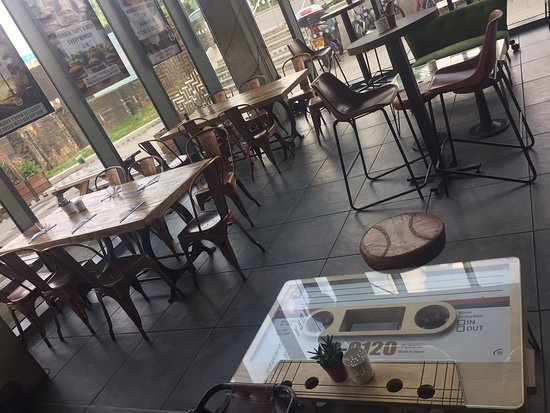 """Willesden, UK: The bar area with quirky """"cassette"""" tables."""