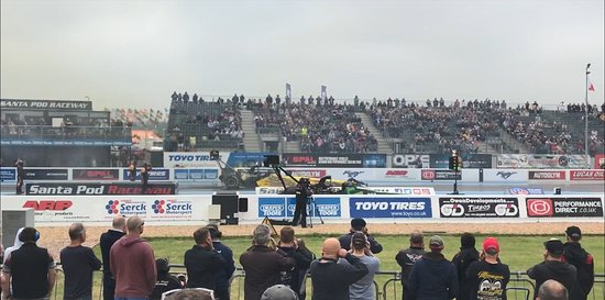 Santa Pod Raceway: 0-100mph in under 1 second (note the people coping with the noise levels)