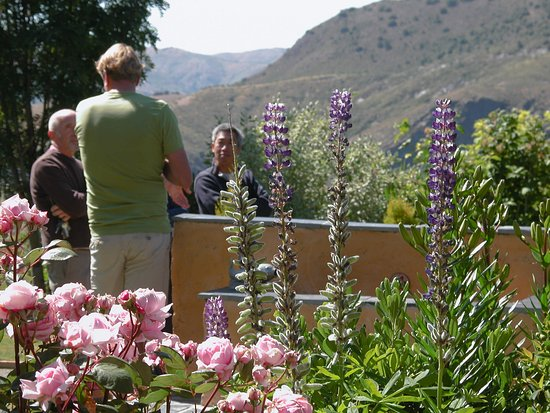 Portugos, Spain: William offering gardening tips to fellow visitors