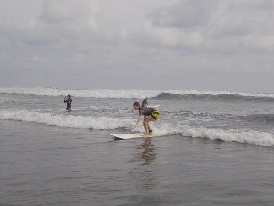 Beginner Surf Lesson: thanks Deb! he's up!