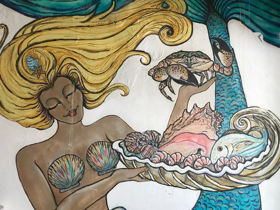 Fish Tales Market & Eatery : Mural on wall in restaurant