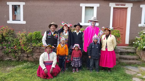 Titicaca For You : Dressing up in traditional clothes with our host family in Llachon