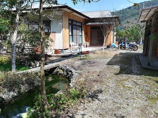 Amami Yamato Guest House Sonouchi: 湧き水の湧く庭つき
