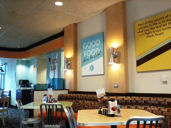 Village Inn: Clean, bright ambiance with pearls of wisdom on display...