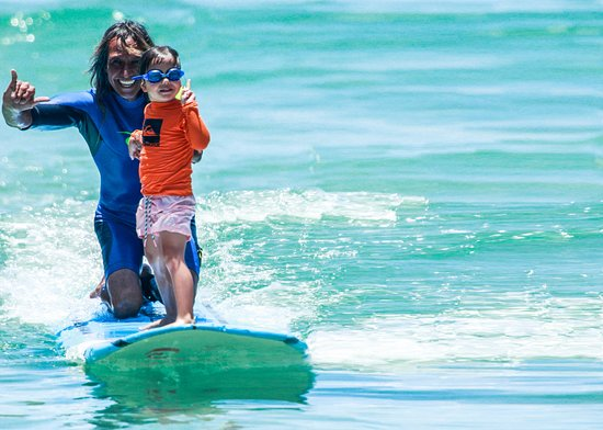 Honolulu, HI: Sparky teaching a 5 year old - you're never too young to learn to surf!