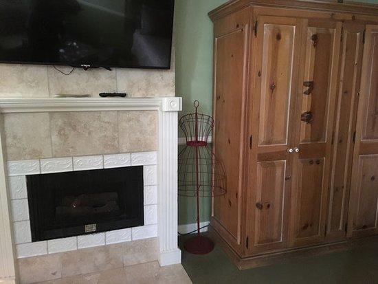 Apple Farm Inn: fireplace, TV, armoire