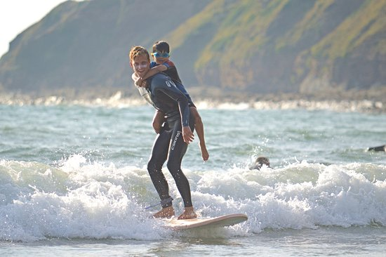 Saunton, UK: We promised we'd get him to see what it was like to stand up surfing ...  We found a way!