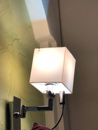 Iberostar Dominicana Hotel: Dirty lamp. Horrible wall decor.