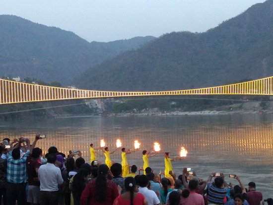 Ganga Aarti with Ram Jhula lit up in the background