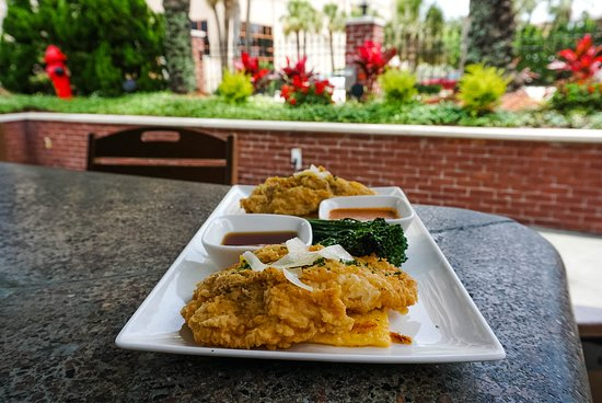 Brix Taphouse: Fish & Grits: Triggerfish (grilled, blackened or fried) served over cheddar grit cake