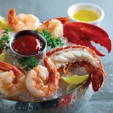 Fogo de Chão Brazilian Steakhouse: Lobster & Shrimp Appetizer: lobster tails, claws, jumbo shrimp with butter, cocktail sauce, lemo