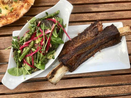 Kootenay Smokehouse: Smoked Beef Rib - tangy fresh garden salad paired perfectly with the rich Smoked Short Rib.