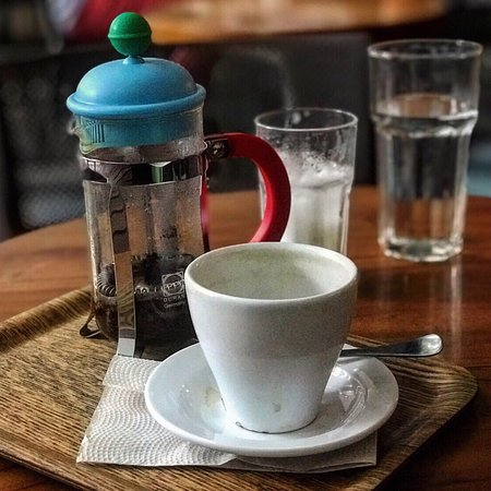 Café Velvet: Cafe Velvet French press & a cold glass of water