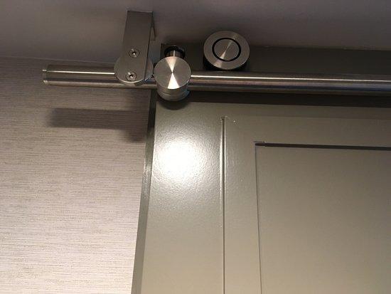 """Seattle Airport Marriott: Type of """"barn-door"""" roller for bathroom door"""