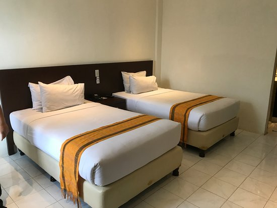 Inna Parapat: Two Single Beds