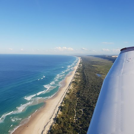 Sky Dance: ...and there she blows! The pristine beaches of Stradbroke Island...nothing but Pacific Ocean no