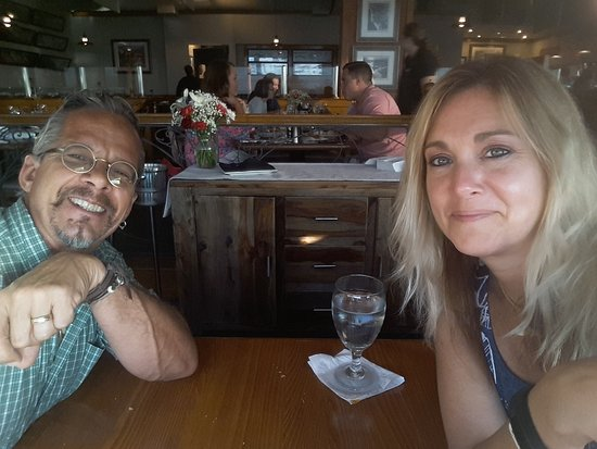 Crow's Nest Restaurant & Marina: This is us at our table after dinner, we are both full and happy with our service and meal. :-)
