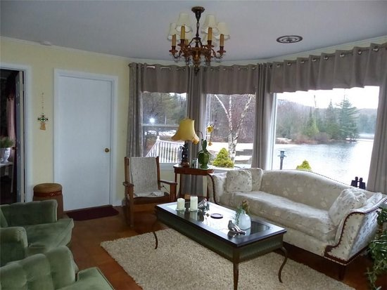Thendara, NY: public area sitting/sun room overlooking the river