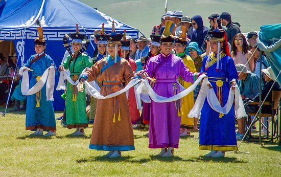 Big Mongolia Travel : The Summer Naadam festival. Be sure to see the dancers in their traditional dress.