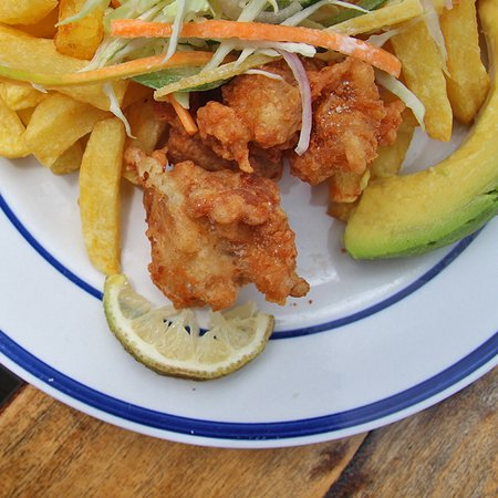 Moroto, Uganda: Battered Nile Perch Fish served with homemade fries and avocado salad. Yum yum