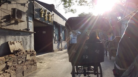 China Holiday Tours: Riding rickshaws through a hutong in Beijing