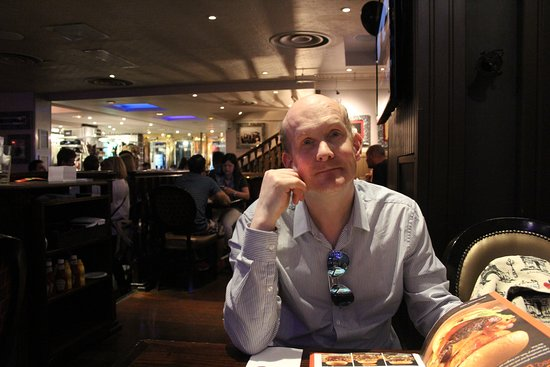 Hard Rock Cafe: My hubby, who can't decide what he wants to eat