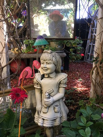 """Spellbound Herb Gift Shop and Garden: Alice and the flamingoes greet you as you enter """"her"""" garden."""