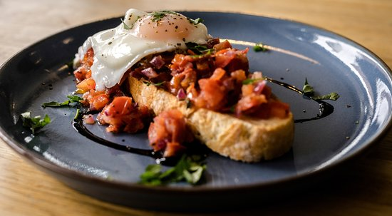 March Hare Kitchen & Deli: Plum Tomato Bruschetta with poached egg